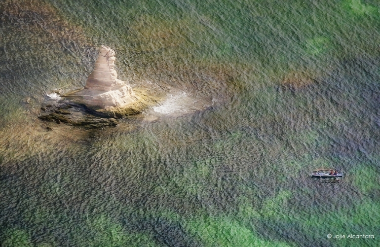 Rock formation in the sea of Albay shot from a chopper by Jojie Alcantara