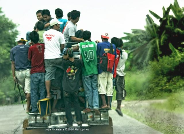 Overloaded jeepney by Jojie Alcantara