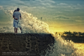 Waves in Times Beach by Jojie Alcantara