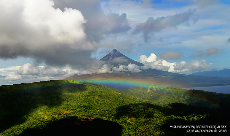 Aerial shot of Mayon Volcano and a rainbow © Jojie Alcantara