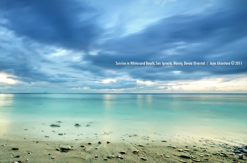 Sunrise in the Ferrando's Whitesand Beach, San Ignacio, Manay, Davao Oriental by Jojie Alcantara
