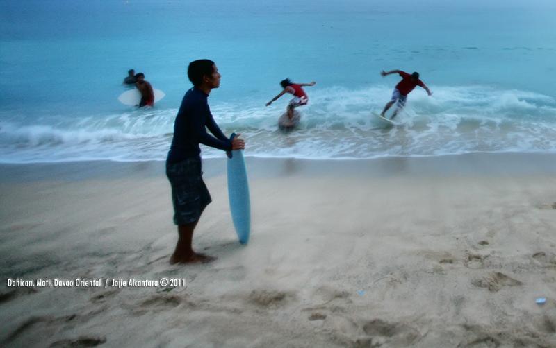 Surfing in Dahican, Mati, Davao Oriental by Jojie Alcantara