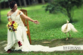 Sarah Velasco and a peacock who dropped by on her wedding