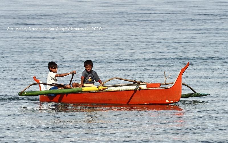 Kids in banca by Jojie Alcantara