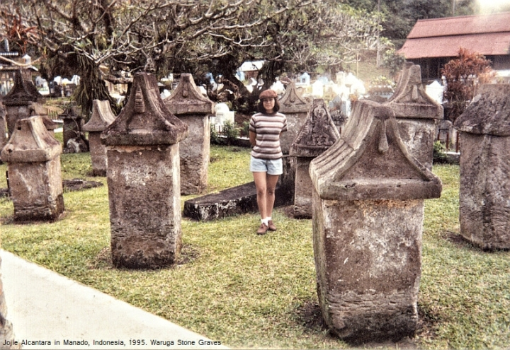 Jojie surrounded by Waruga sarcophagi in Manado