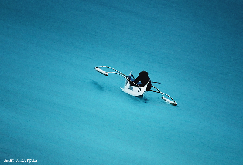 Boatman at sea by jojie alcantara