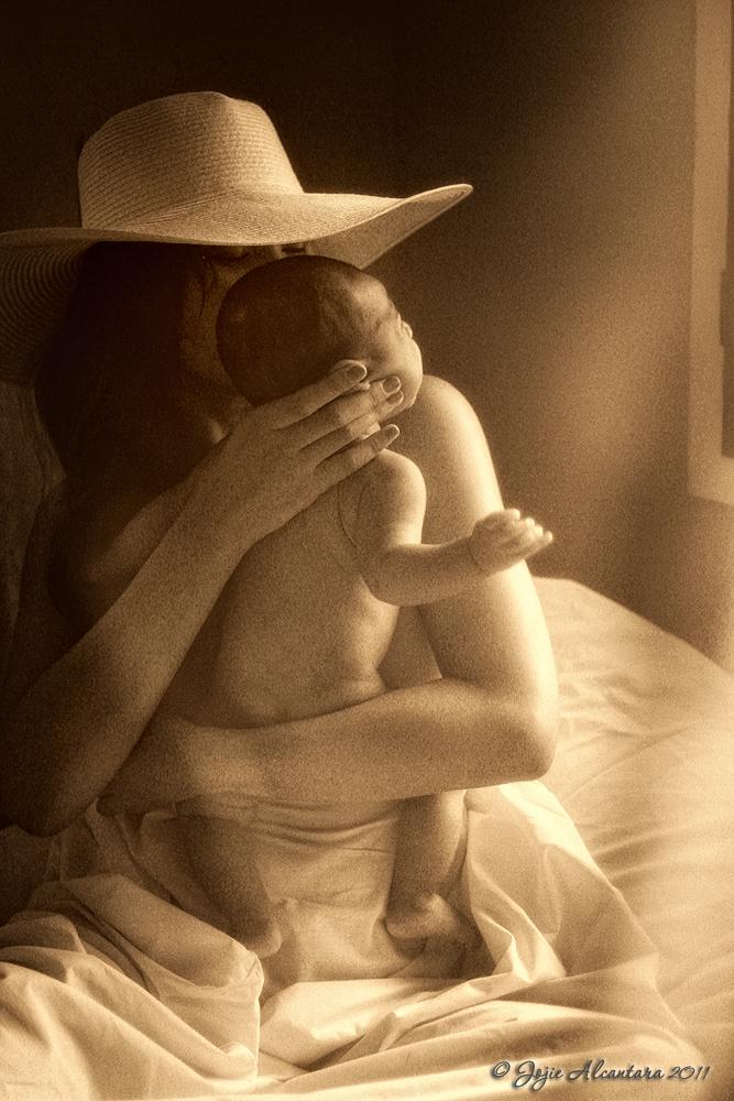 Motherhood is a fine art by Jojie Alcantara