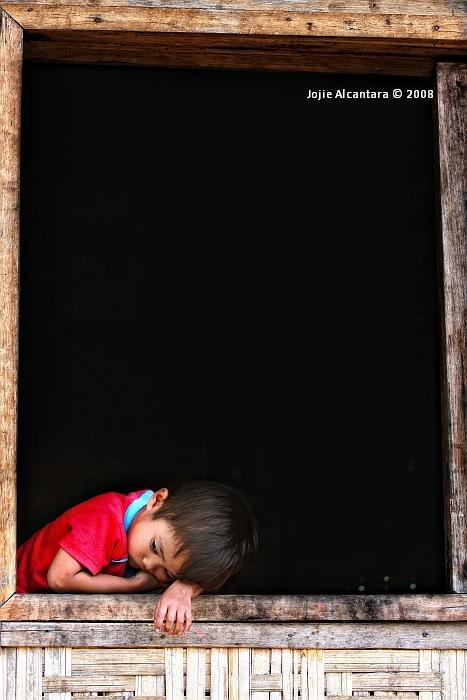 Bagobo child in window by Jojie Alcantara