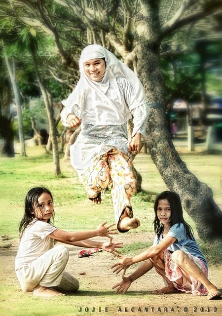 Kids play Luksong Tinik in Magsaysay Park