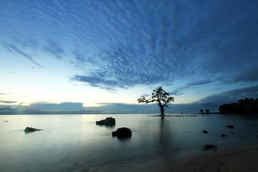 Punta Dumalag at sunrise by Jojie Alcantara