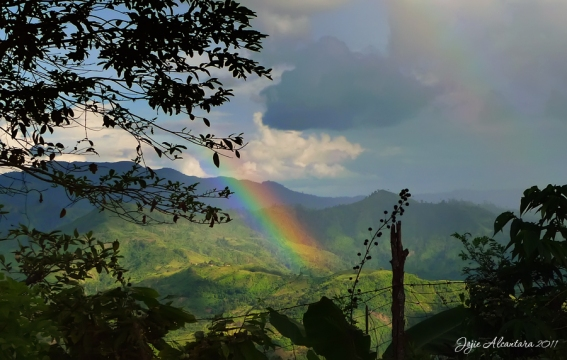 Rainbow over the valley by Jojie Alcantara