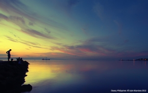 Sunrise and seascape © Jojie Alcantara