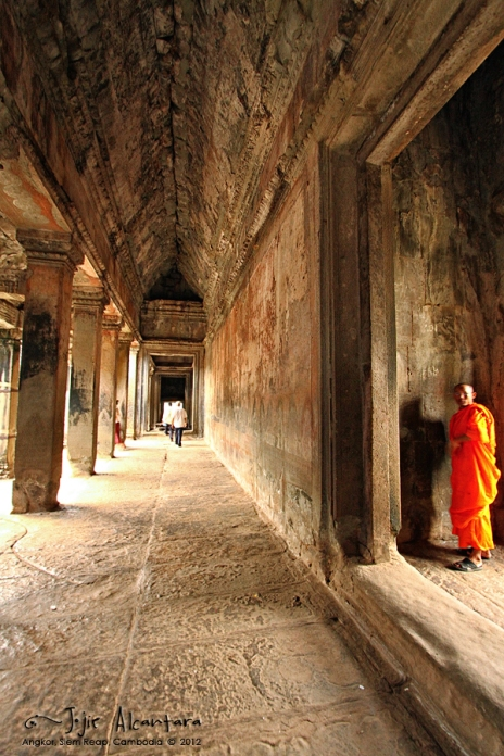 Monk inside Angkor by Jojie Alcantara