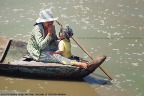 Mother and child in Tonle Sap Lake by Jojie Alcantara