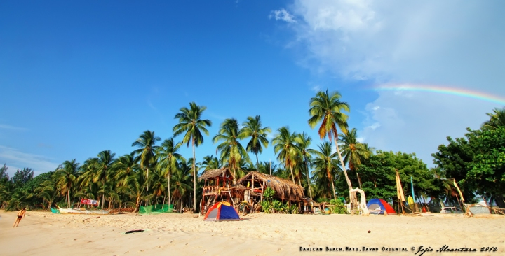 Beach panorama with rainbow © Jojie Alcantara 2012