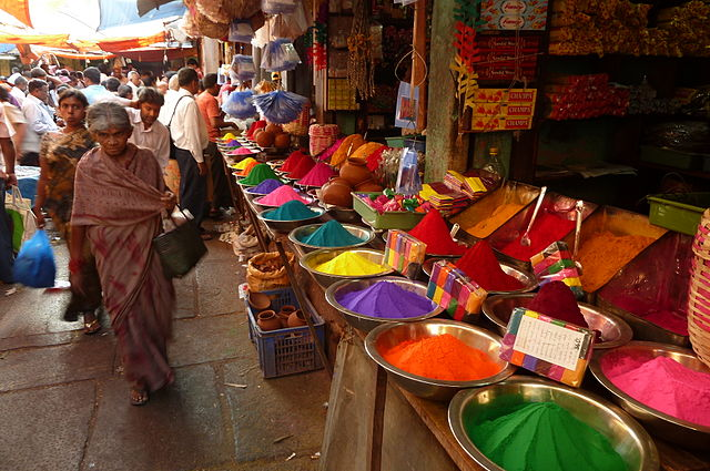 Colors for the Holi Festival at a market in Mysore, India by Nikolas Beker (Wikimedia Commons)