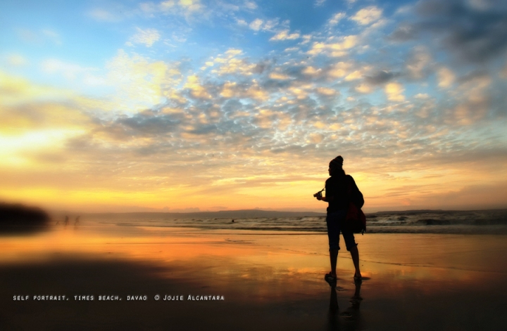 self portrait at times beach by Jojie Alcantara