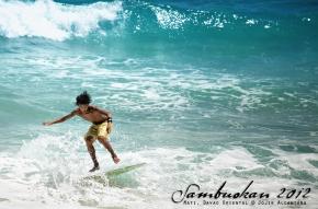 Skimboarding Dahican's waves © Jojie Alcantara