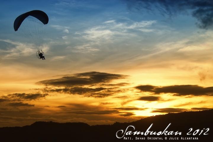 Paramotor glider in the sunset at Mati Baywalk  |  Jojie Alcantara
