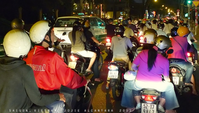 Saigon traffic at night by Jojie Alcantara