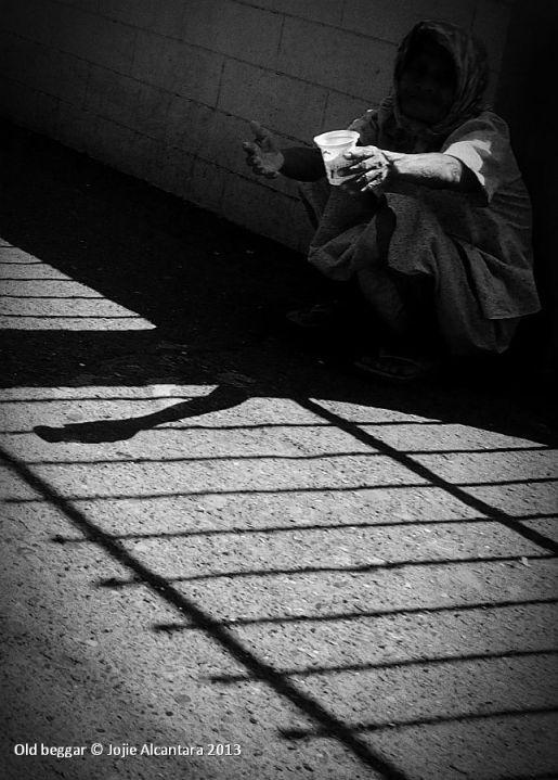 Beggar in San Pedro Cathedral © Jojie Alcantara