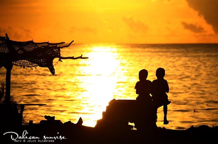 Dahican sunrise by jojie alcantara