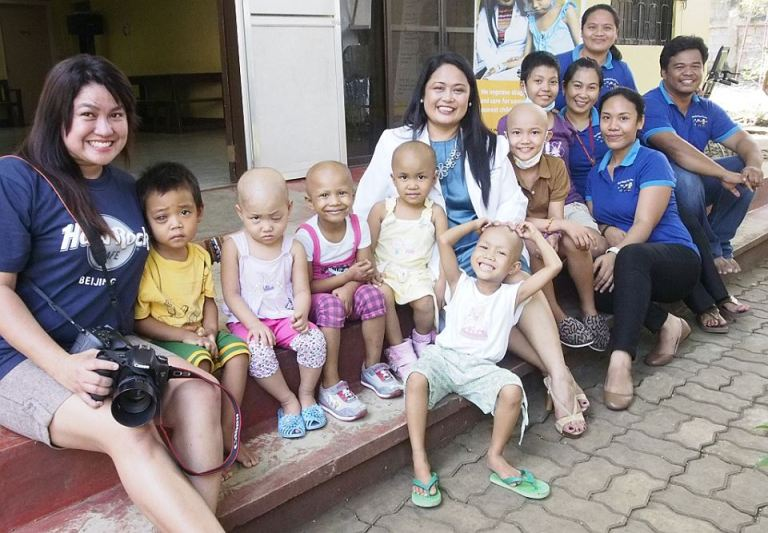 Jojie with the Kids of Hope cancer patients and founder Dr. Mae Dolendo