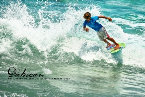 Panggoy playing with the waves in Dahican by Jojie Alcantara 2