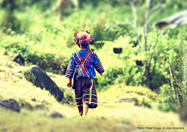 Kid in Tibolo Tribal Village by Jojie Alcantara