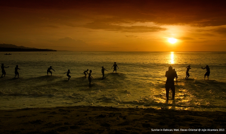 Skimboarders at sunrise with Jojie