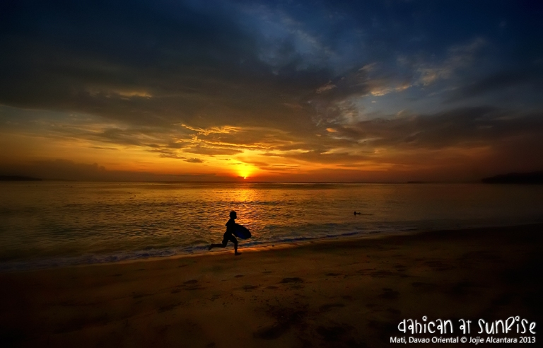 Skimboarder at sunrise in Mati  © Jojie Alcantara 2013
