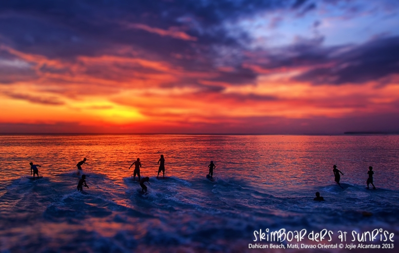 Skimboarders at sunrise in Mati, Davao Oriental  © Jojie Alcantara 2013