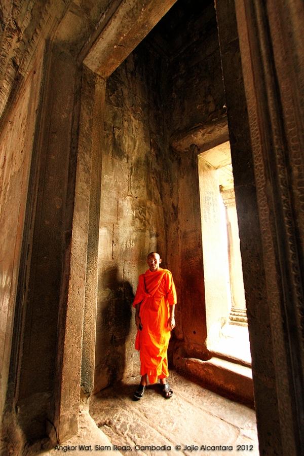 Monk in Angkor Wat Temple  © Jojie Alcantara