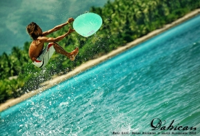 Panggoy playing with the waves in Dahican by Jojie Alcantara