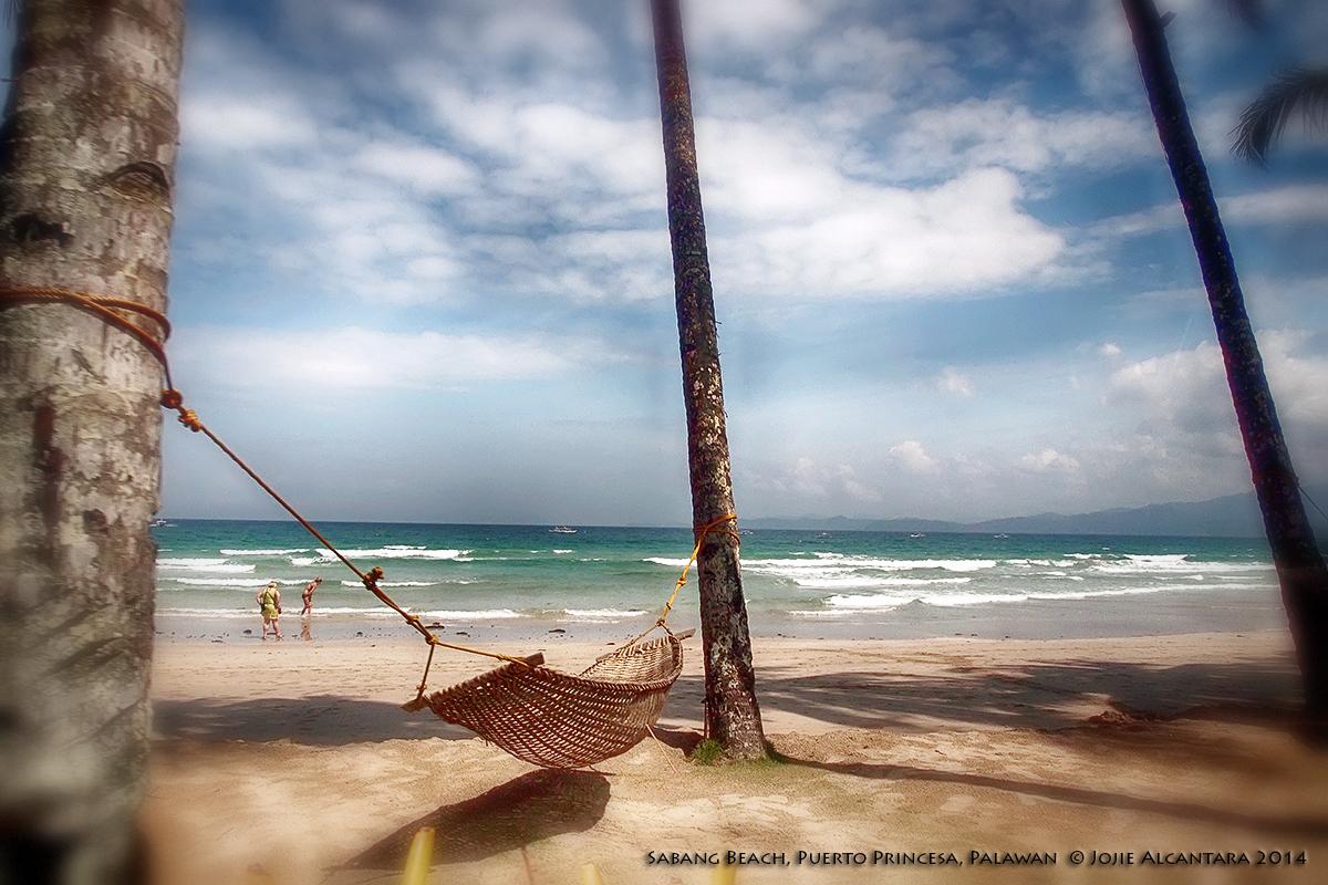 Sabang Beach Palawan by Jojie Alcantara