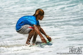 Panggoy playing with the waves in Dahican by Jojie Alcantara 3