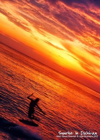 Skimboarder at sunrise