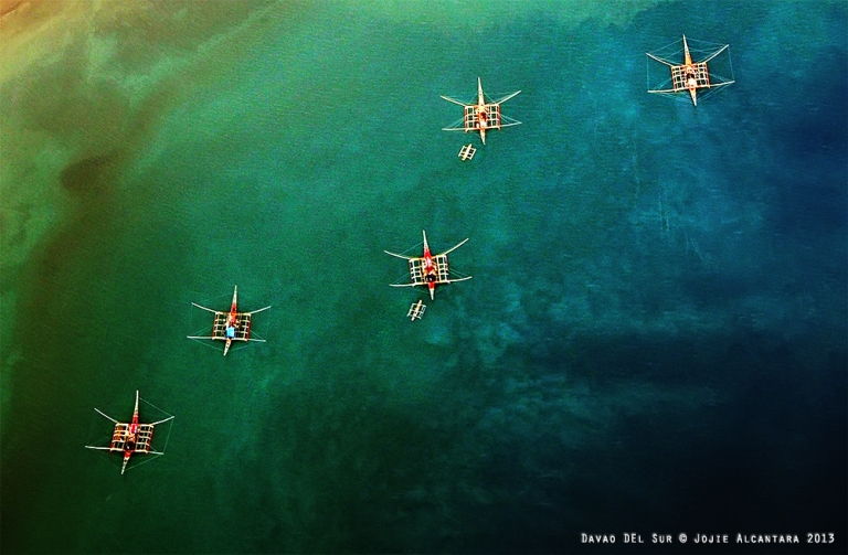 Star-shaped fishing boats as seen from inside a Cessna plane © Jojie Alcantara 2013
