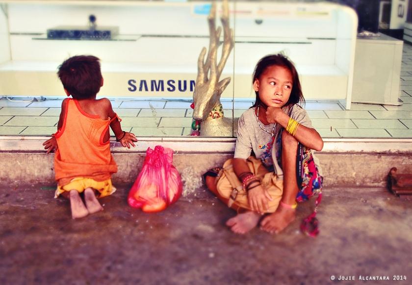 Street kids by Jojie Alcantara