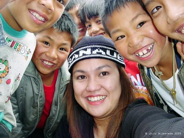 Selfie in 2003 with Banguet kids from a remote village in Banaue, 20013 © Jojie Alcantara