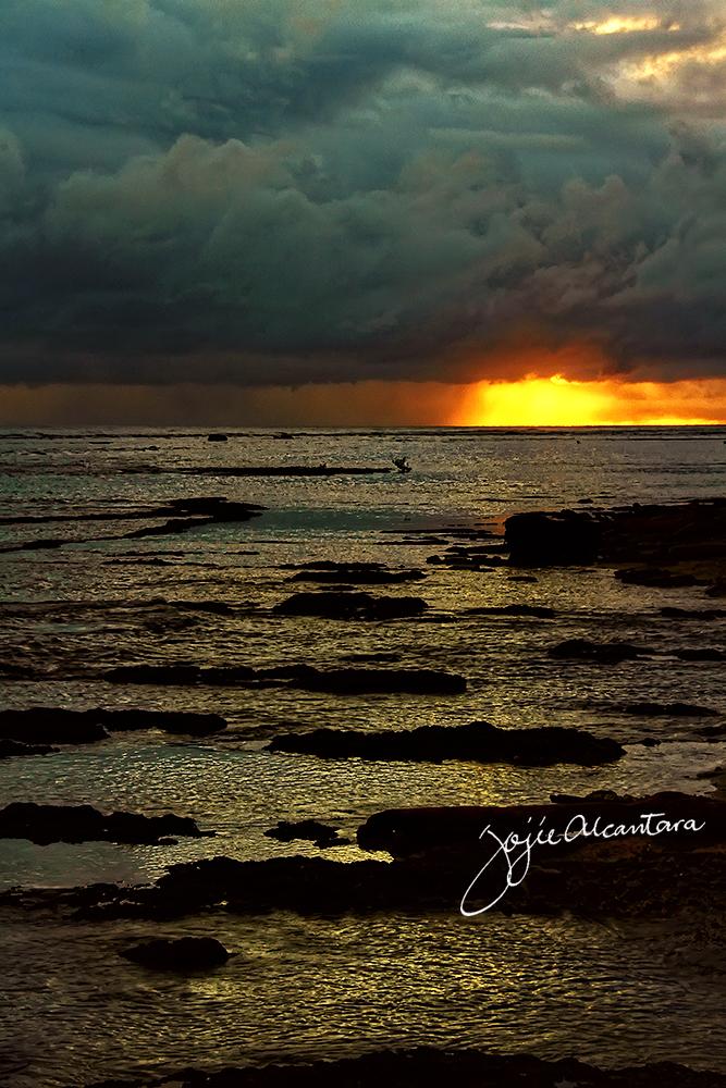 Sunrise in Cateel by Jojie Alcantara