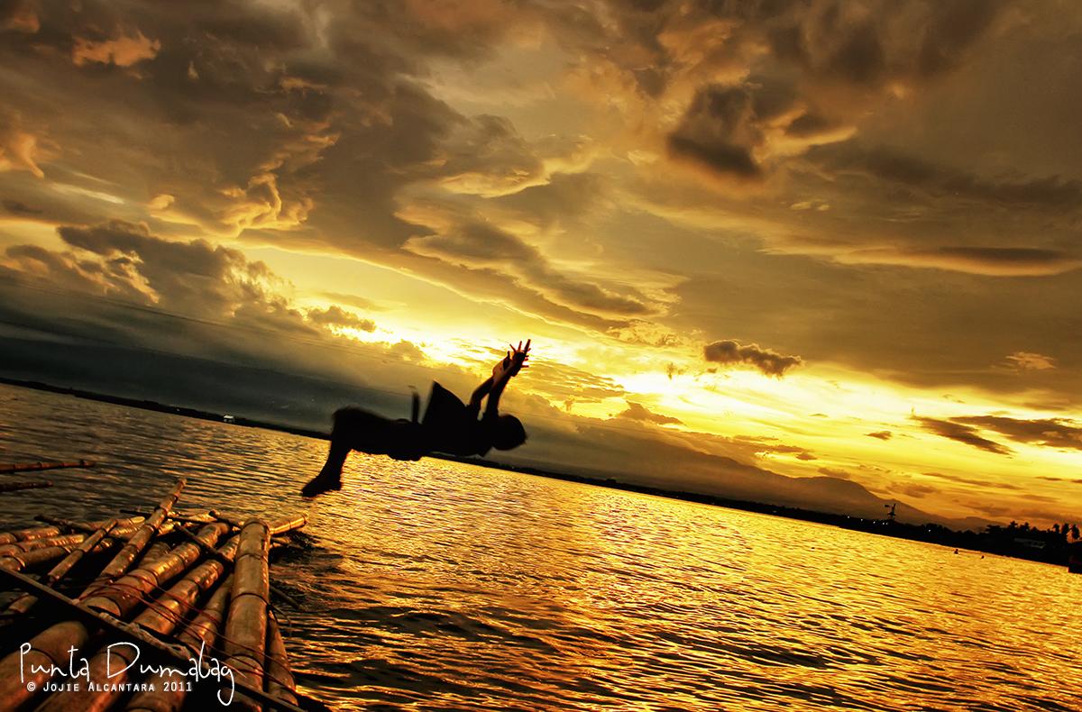 Punta Dumalag at sunset by Jojie Alcantara
