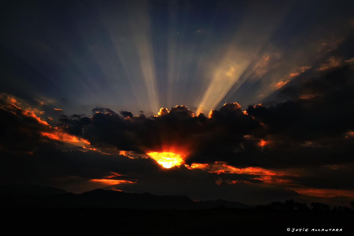 Sunset in Polomolok by Jojie Alcantara