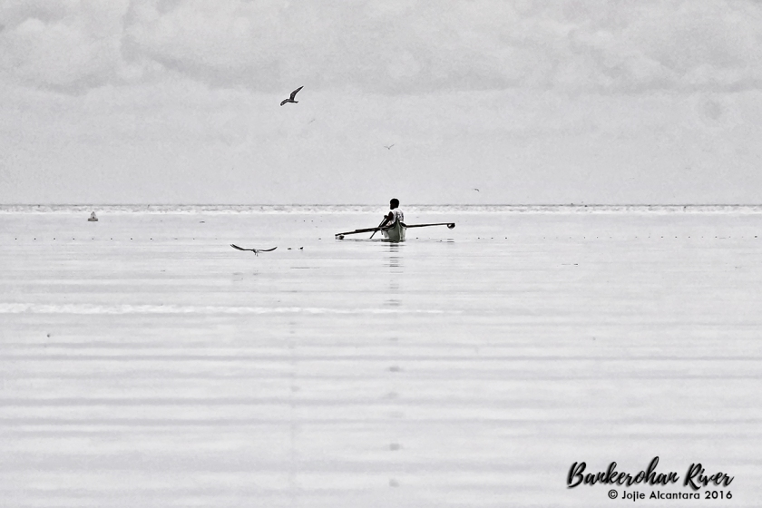 Fisherman in Bankerohan River © Jojie Alcantara